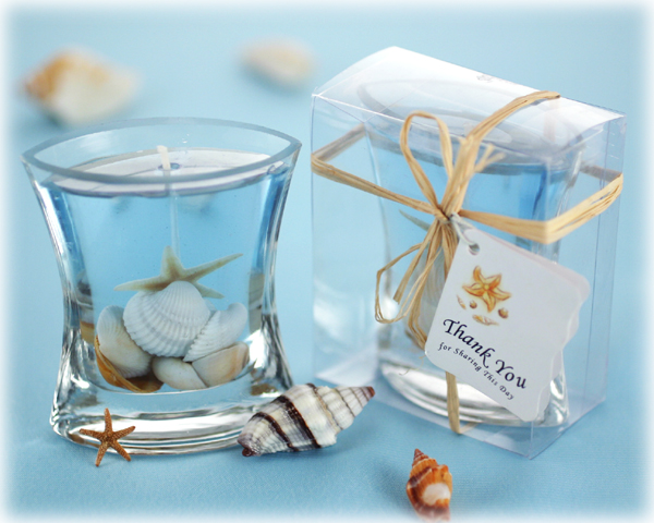 "<center>""Seashells"" Gel Candle in Clear Box with Raffia Tie</center>"